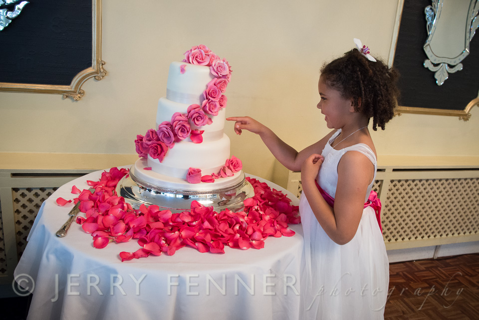 Cheeky flower girl after the wedding cake at The Lord Bute