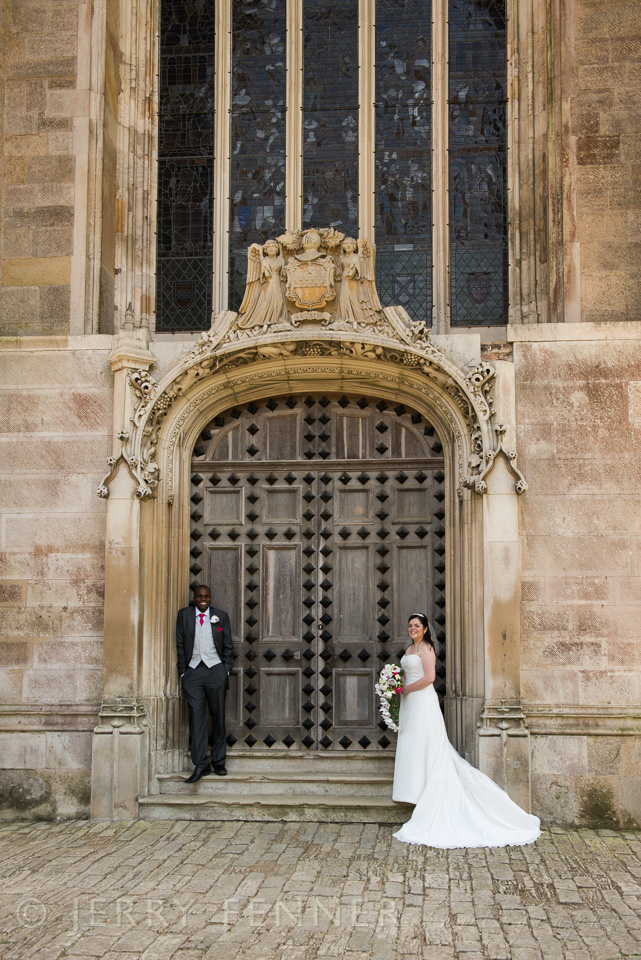 The groom and his bride on the steps at Highcliffe Castle