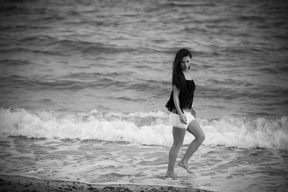 Black and white photo, pretty girl at the beach