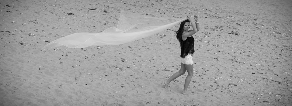 Black top, white shorts, pretty girl at the beach