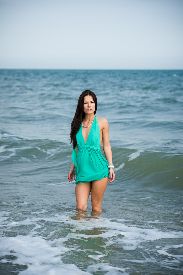 In the sea in a sexy green green dress