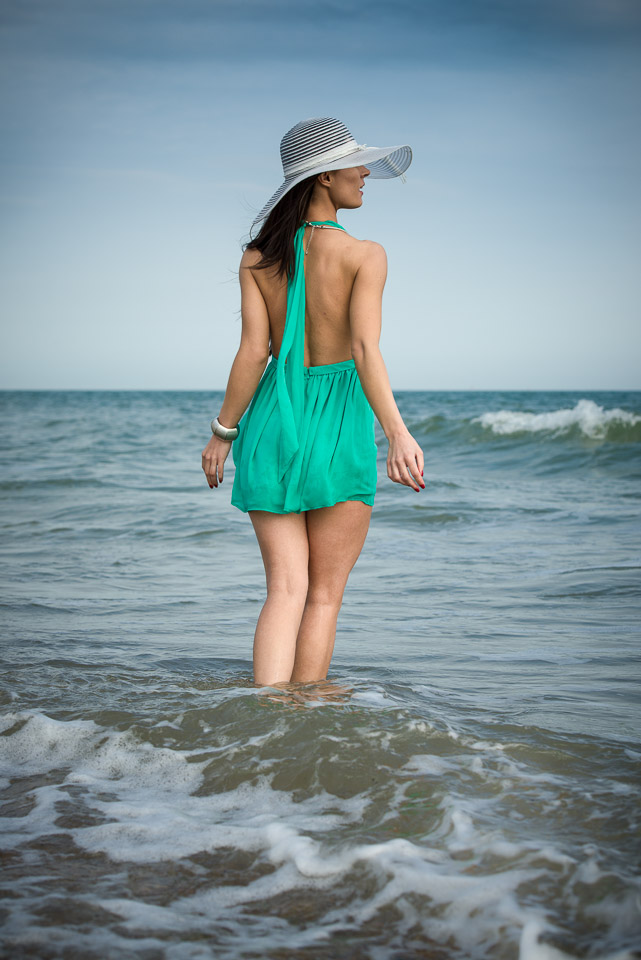 Looking fabulous, hat and dress in the sea, beach photography