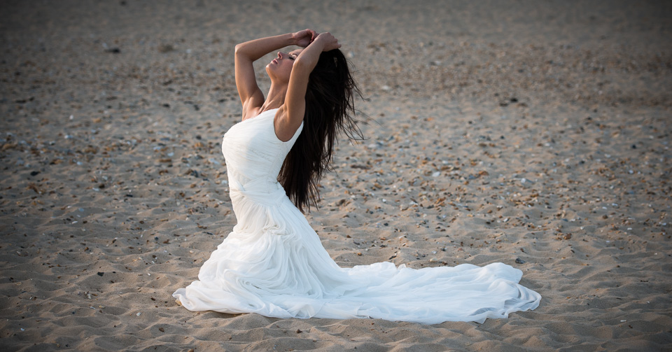 Beach photography in her wedding gown