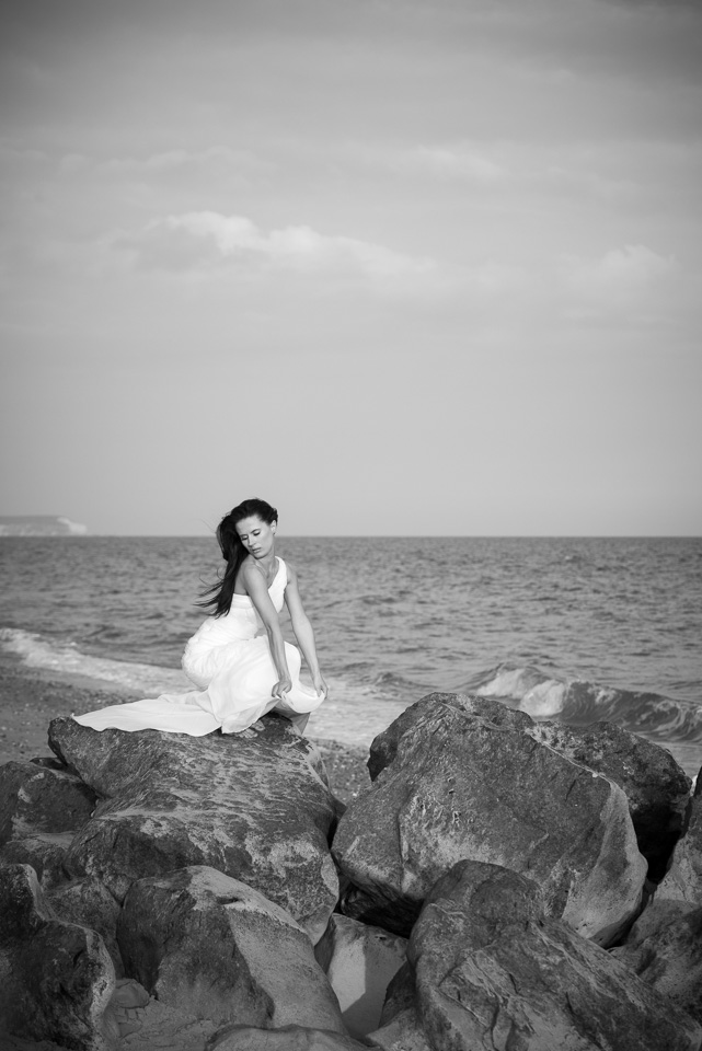 Wedding gown on the rocks at the beach