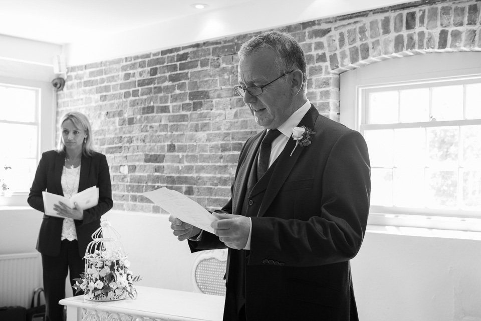 A reading during their Sopley Mill wedding