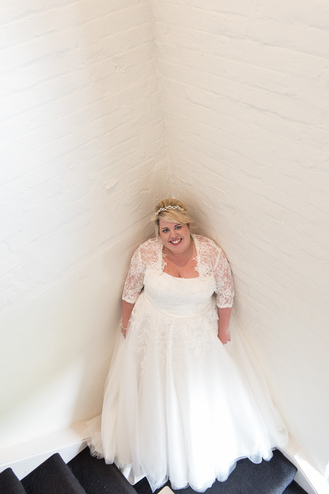 Bride on the stairs at Sopley Mill