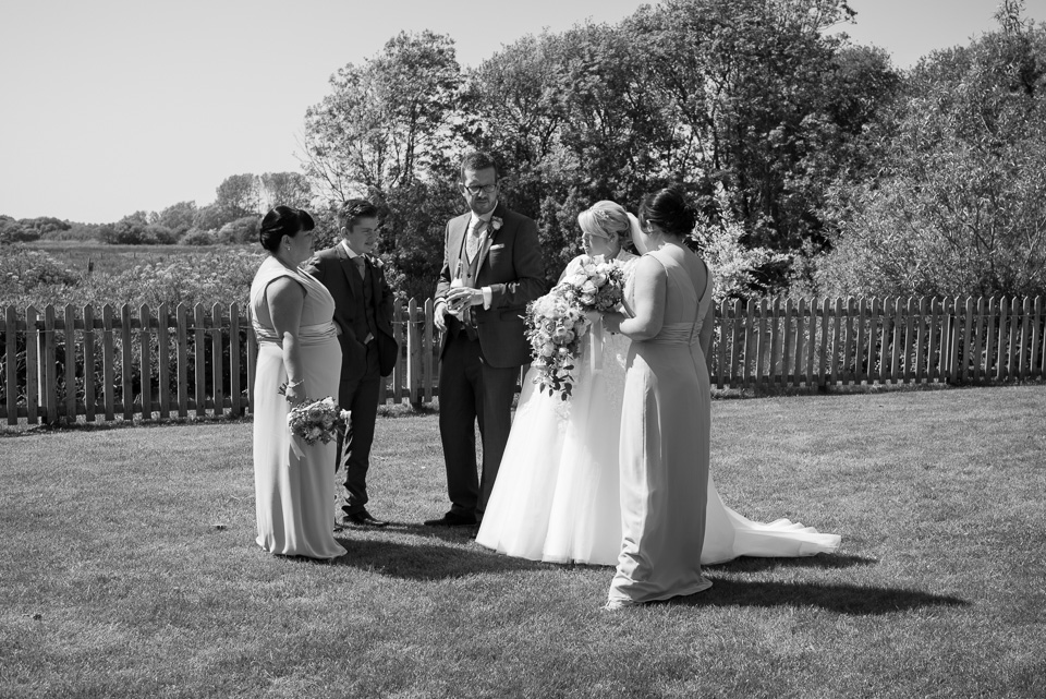 Chatting in the gardens at Sopley Mill Weddings