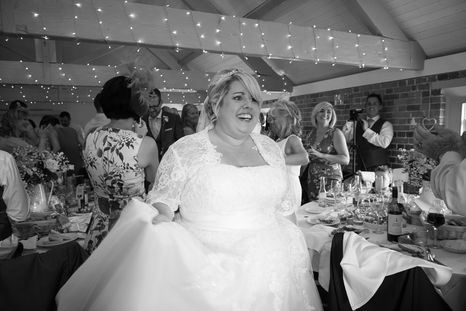 Happy bride at Sopley Mill Wedding reception