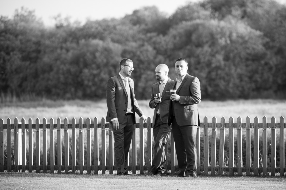 The groom and mates chatting and drinking
