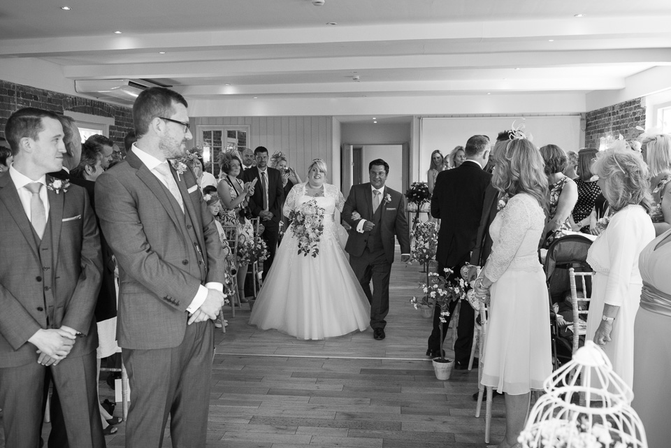 The groom seeing his bride for the first time at Sopley Mill