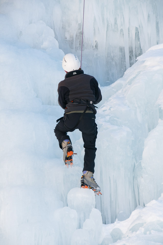Abseiling down a frozen waterfall with Undiscovered Alps