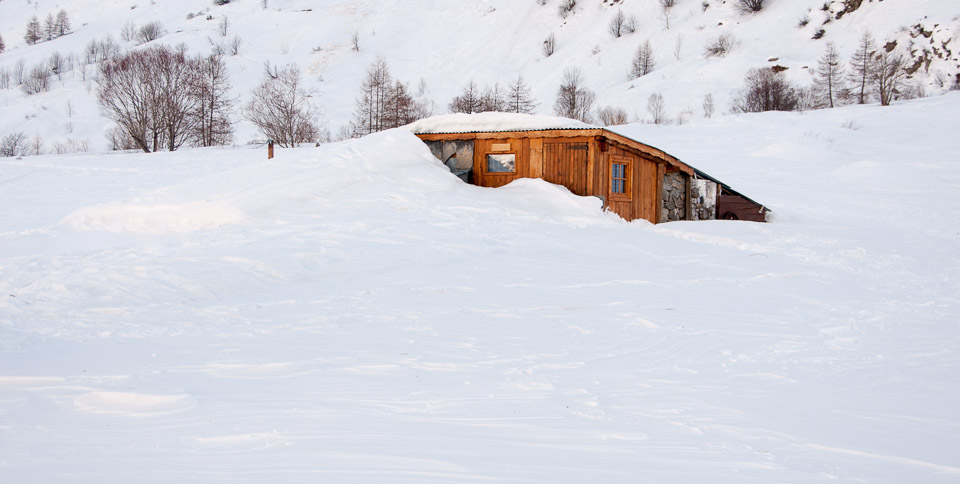 Snow-covered shepherds cabin with Undiscovered Alps