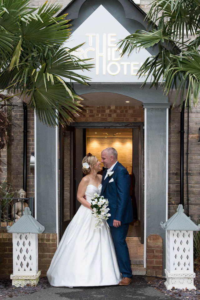At the entrance to their wedding venue, Orchid Hotel, Bournemouth