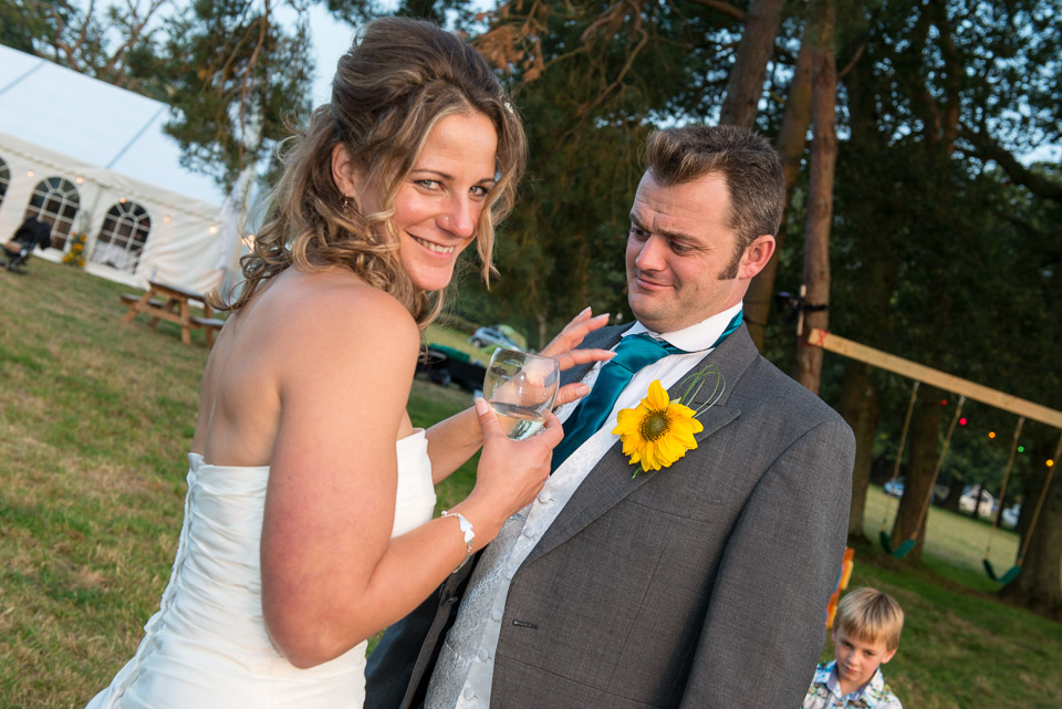 Checking his cravat before wedding photography in the New Forest