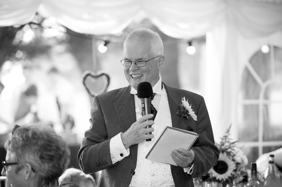 Father of the bride giving his speech at this marquee wedding in the New Forest