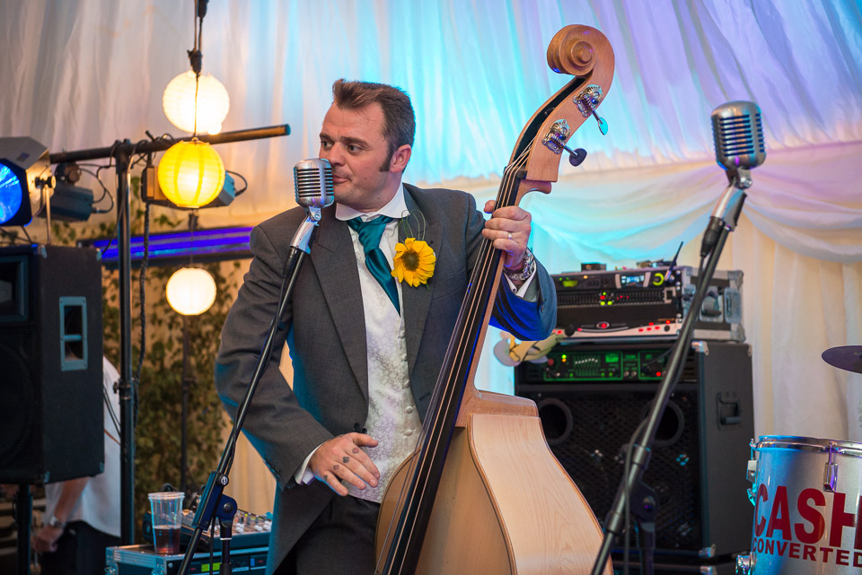 Groom playing in the band for the evening entertainment Cash Converted new Forest wedding
