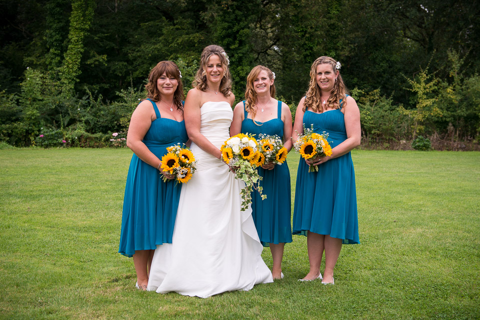The brdie and her bridesmaids in her parents garden in the New Forest