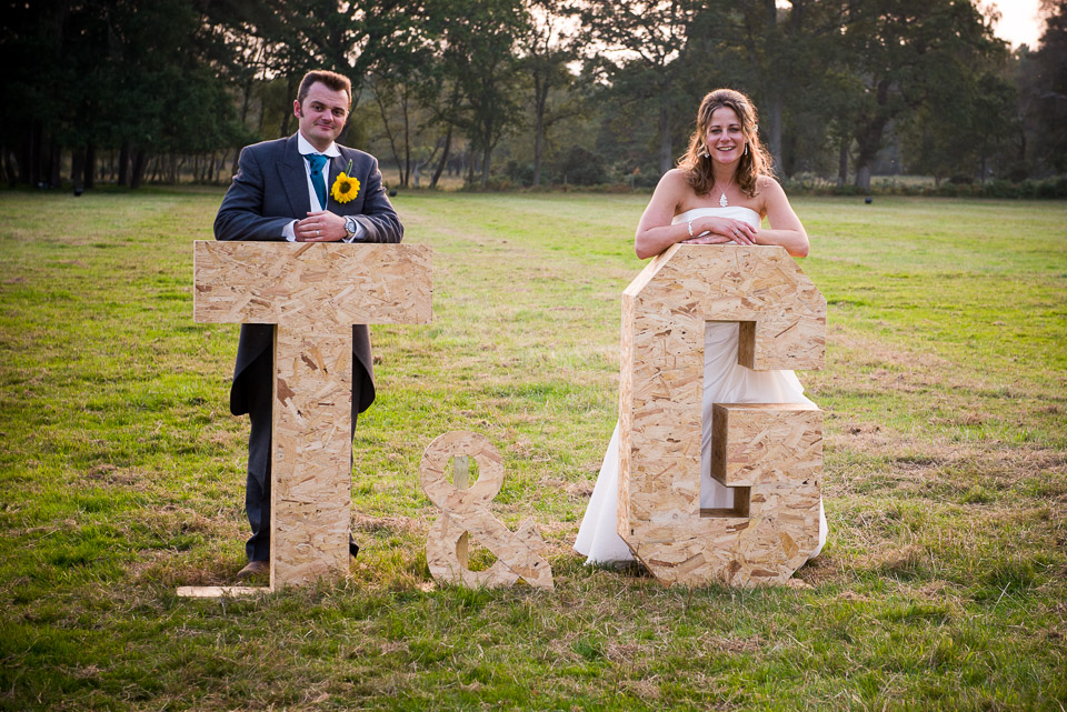 Wedding photography in the New Forest, Tom and Gilly posing with their initials