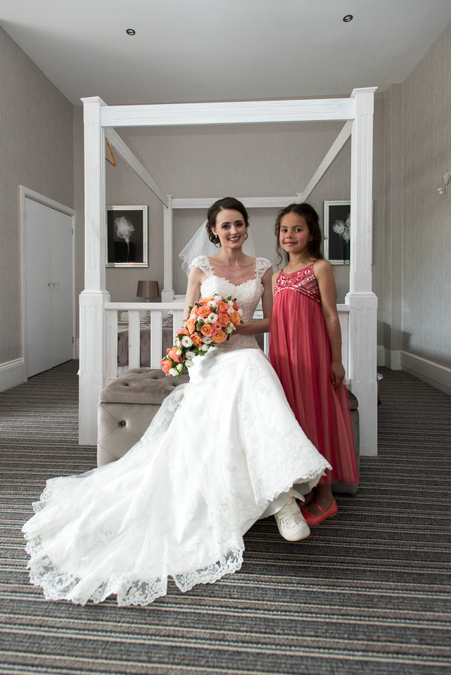 The bride with her flower girl at The Queens Hotel in Bournemouth